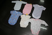 Baby body suit 100% cotton.