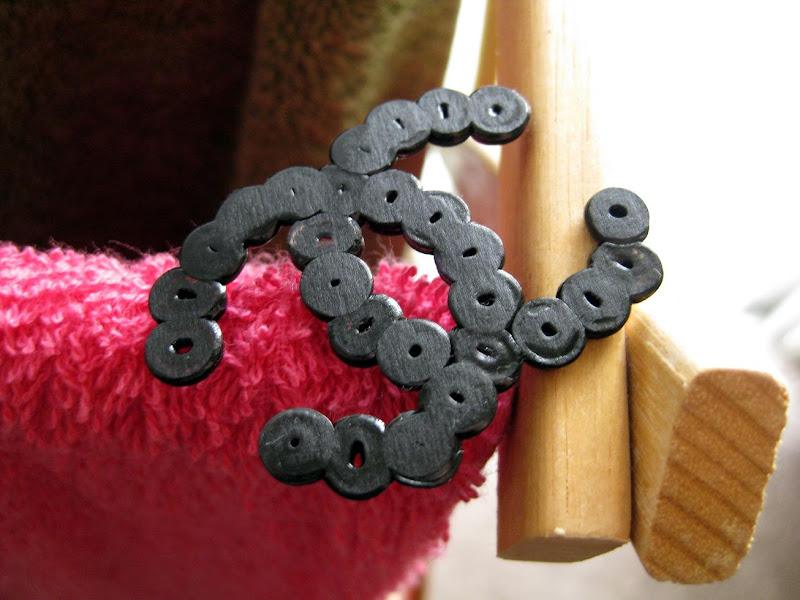 fake double-C Chanel logo in Perler beads