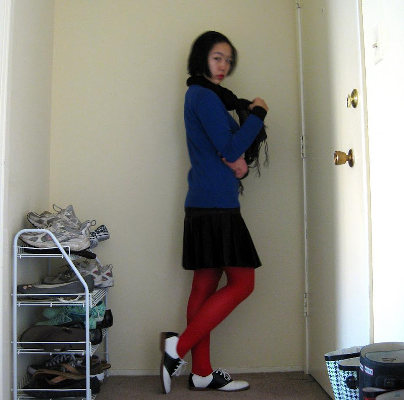bright red tights, royal blue sweater, black and white saddle shoes