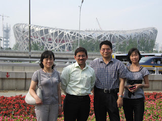With my hosts at the Bird's Nest Olympics Stadium in Beijing