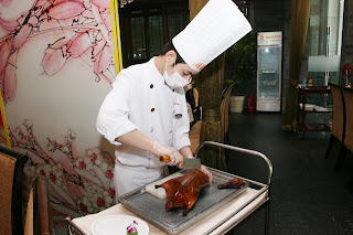 Carving Duck at the table in Beijing
