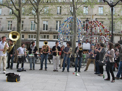 Musicians play outside the Louvre