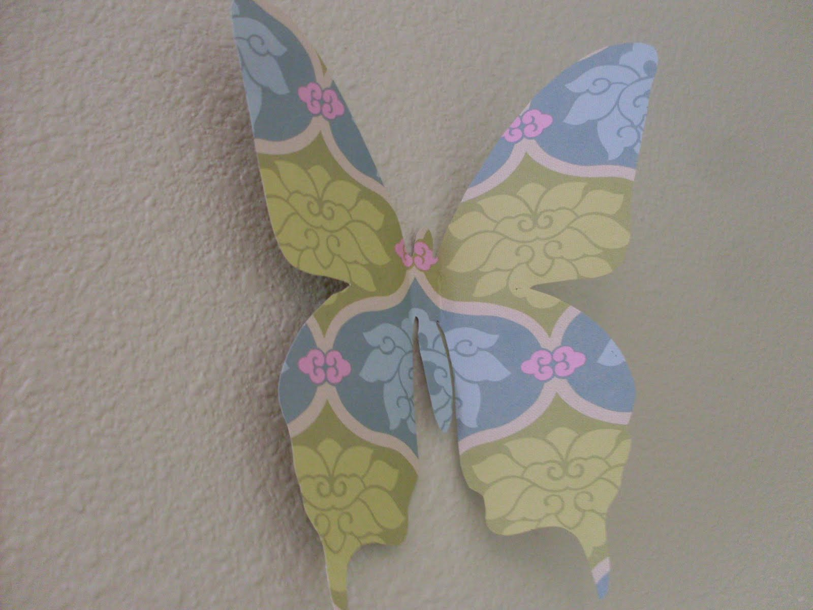 Two crazy cupcakes girl power paper butterfly wall decor for How to make paper butterflies for wall