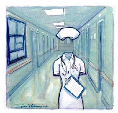 Sygeplejerske-dragt på hospitalsgang