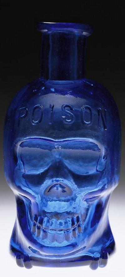 Blå kranium-gift-flaske