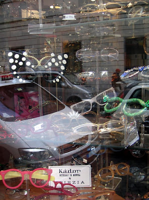 Many reflections in a shop window, Piazza del Popolo, Rome, Italy