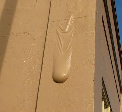 Paint Holding Water - Hunts' Building, Astoria, Oregon