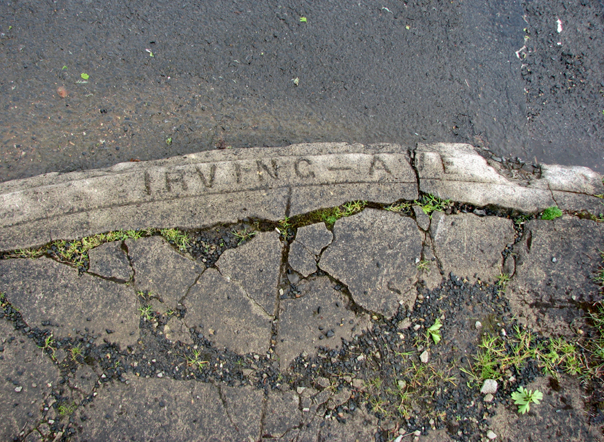 Name stamped in the pavement, Irving Avenue, Astoria