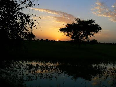 Imagini Djenne: apus de soare pe Niger