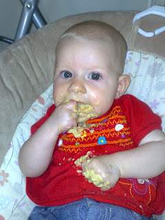 Baby eating spreads
