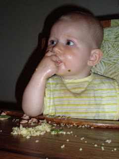 baby eating couscous