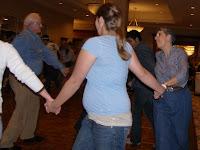 Nedi Rivera square dancing, with husband in the square