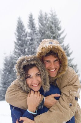 happy couple in snow