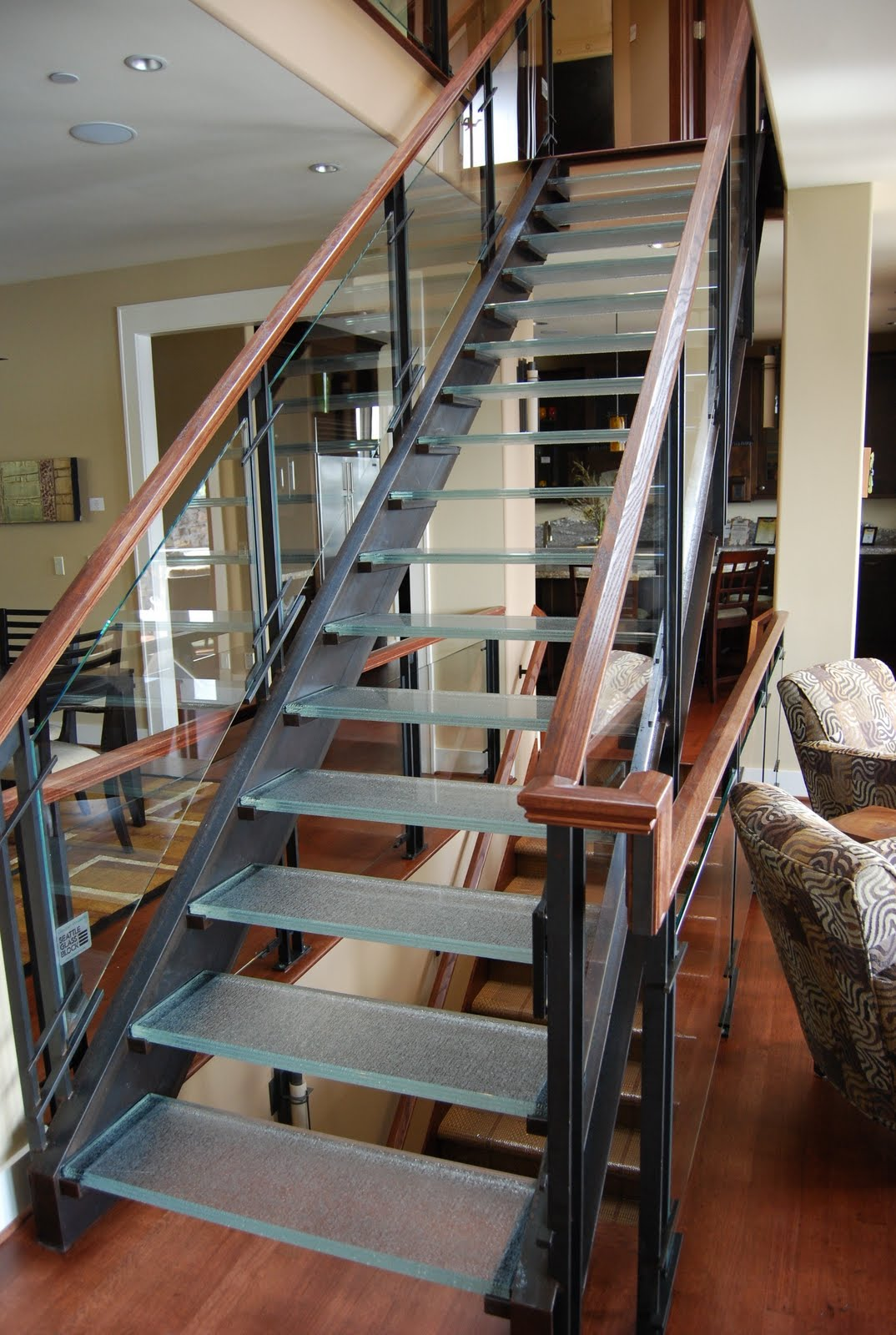 ... Staircase Incorporated Glass As The Main Component To Allow Light To  Flow From The Skylight Above To All The Living Spaces Below. The Glass  Stair Treads ...