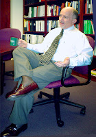 Steve, in a meeting, wearing off-black ActivSkin legwear