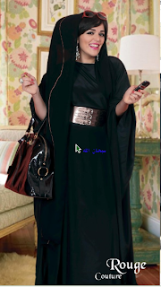 woman in black abaya with many accesories