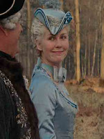 Young Marie Antoinette makes a funny face while talking to king Louis XV, a film still from the 2006 film Marie Antoinette
