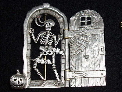 This skeleton hides behind the castle door waiting to pass out treats at Halloween.