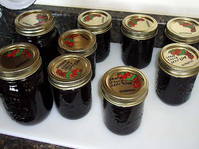 The grape jelly is left to cool before storage.