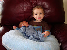 Nicholas holding William for the first time