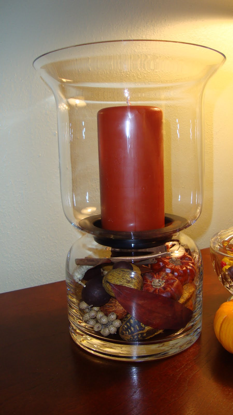 Jk homestead autumn decor on the coffee table we took a leaf plate and put in it 2 fall candles and a small bundle of sticks taken from the vase filler used in the candle holder reviewsmspy
