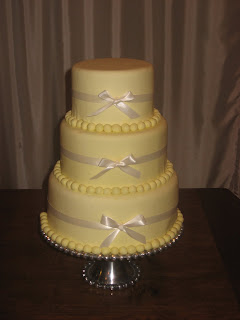 yellow wedding cake, cake with bows, fondant cake, las vegas wedding cakes