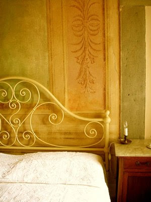 bed in Tuscan villa via Shootfactory UK