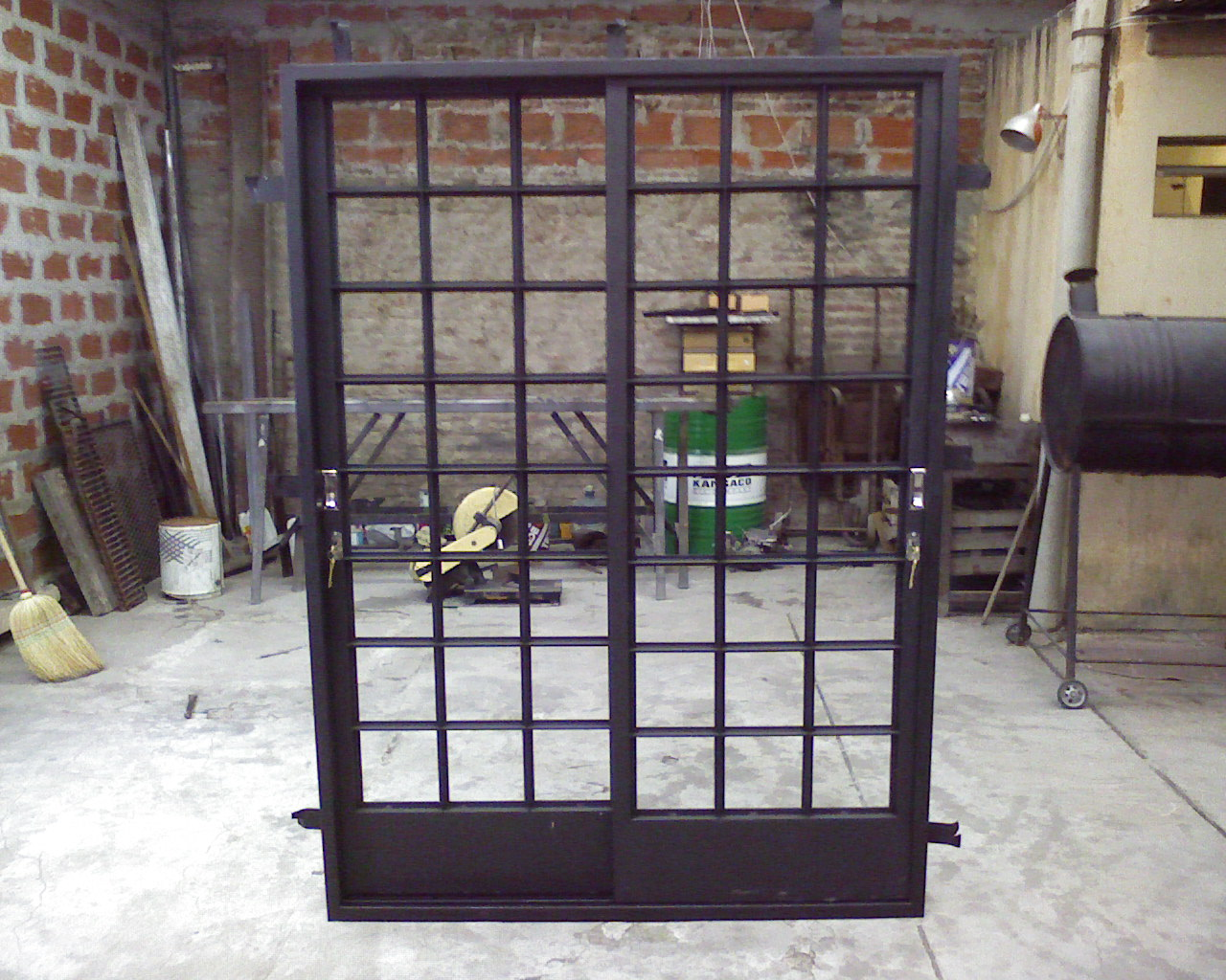 Herreria damatto aberturas for Puertas corredizas de metal