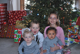 The kids in their Christmas outfits right the Sunday before Christmas.