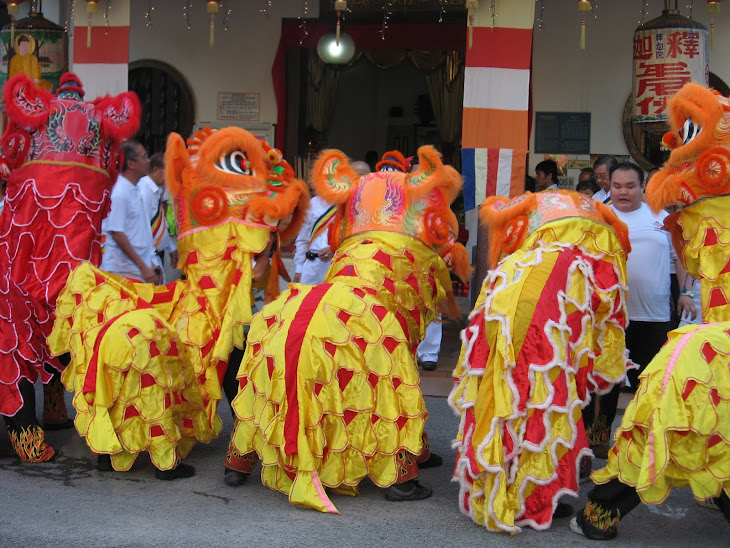 Lion dances performing before the start of the procession