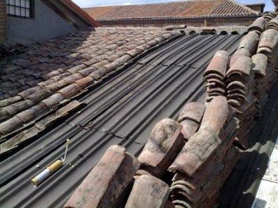 Impermeabilizar tejado tejados a reformar en madrid for Impermeabilizar terraza transitable