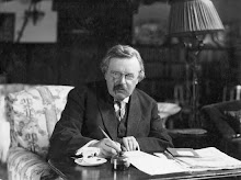 GK Chesterton, at his desk