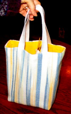 Bag in handwoven cotton yarns.