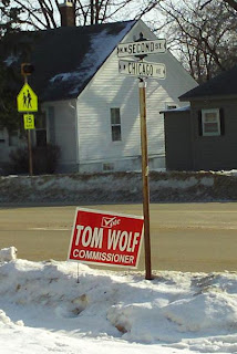 Campaign Sign: Vote Tom Wolf, Commissioner, 2nd and Chicago, Madison, SD
