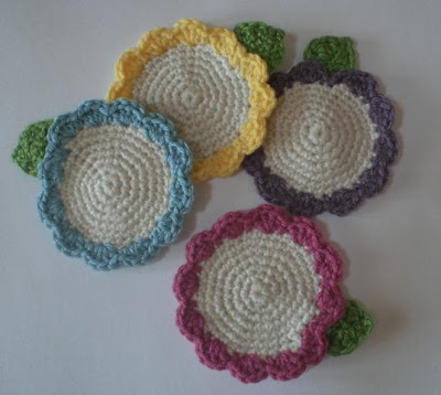 Crochet potholders, dishcloths, trivets and coasters on