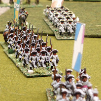A column of French infantry slogs its way across the hot dusty countryside somewhere in Flanders..