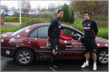Neil Dymock in one of the cars along with Wales players Lewin Nyatanga and Gareth Bale
