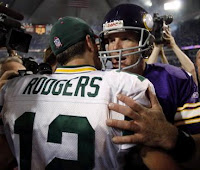 Favre giving former teammate Rodgers a hug after the game