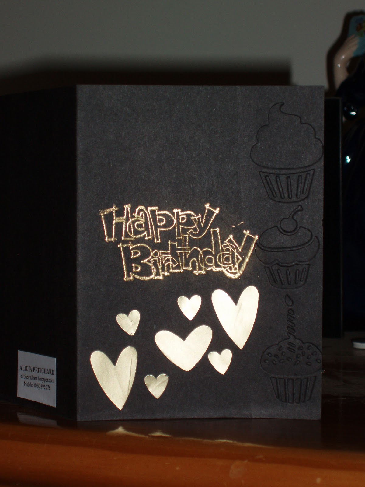 Embossed Some Cupcakes On Black Card And Used Clear Versamark Stampin Up Gold Embossing Powder To Create Happy Birthday From Outlined