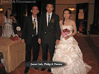 Jason Geh posing with newly weds Philip and Petrina