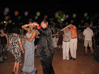 the guest dancing to the beat of the live band