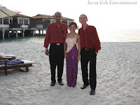 The three piece Live Band from Jason Geh Entertainment posing at the beach wedding