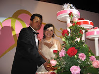 Cake cutting ceremony of the wedding couple