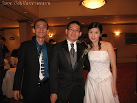 Band manager Jason Geh with wedding couple Adrian and Shao Yi at the foyer