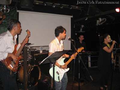 Image of a live band performing during a club gig in Kuala Lumpur , Malaysia