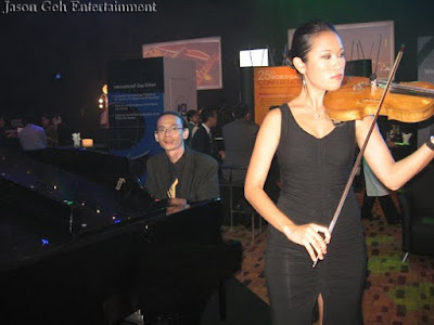 Violinist and Pianist performing live at WGC launch