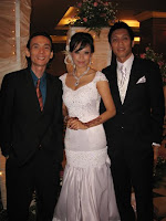 Jason Geh flanked by bridal couple