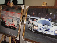 Portraits of Porsche cars at the foyer