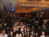 An image of the restaurant filled with guests