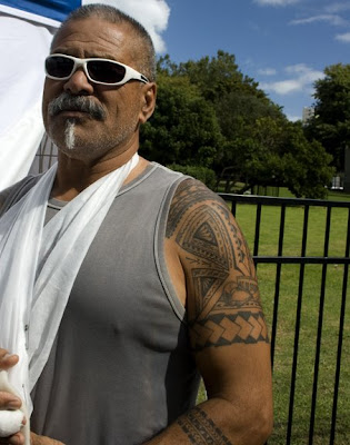 A Maori vendor proudly wears his moko (tattoos). The moko tell the ancestral